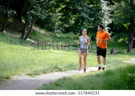 Couple jogging and running outdoors in nature #517840231
