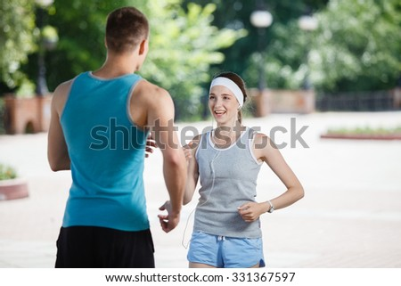 couple jogging in park at morning. Health and fitness.