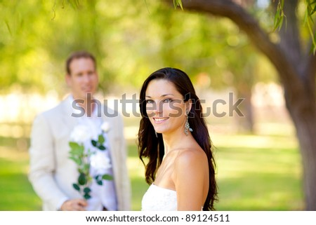 couple just married with man holding flowers in hand