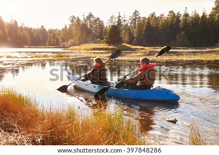 Couple kayaking on lake, back view, Big Bear, California