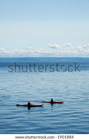 couple kayaking on the sea