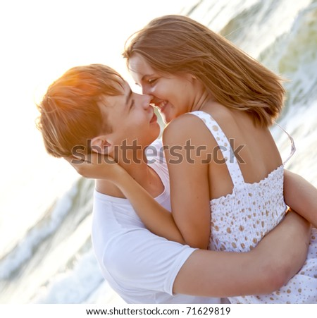 Couple kissing at sunrise