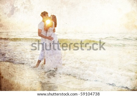 Couple kissing at sunrise. Photo in old colour image style.