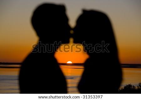 couple kissing sunset. stock photo : Couple Kissing