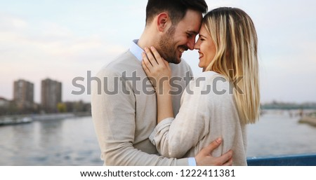 Couple kissing dating on bridge #1222411381