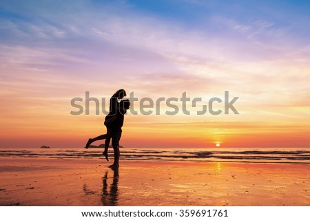 couple kissing on the beach...
