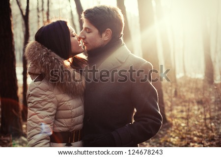 couple kissing on the nature