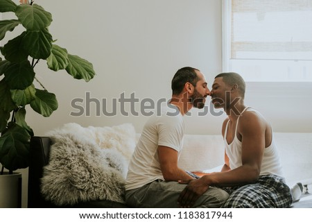 Couple kissing on the sofa