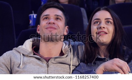 Couple laughs at the movie theater