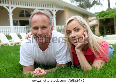 Couple laying down in house garden