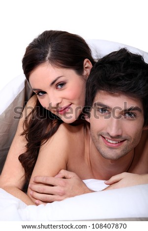 Couple laying in their bed