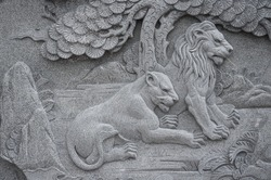 Couple lion marble carving wall in the Chinese public temple