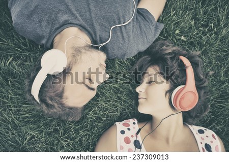 Couple listening to music on headphones #237309013