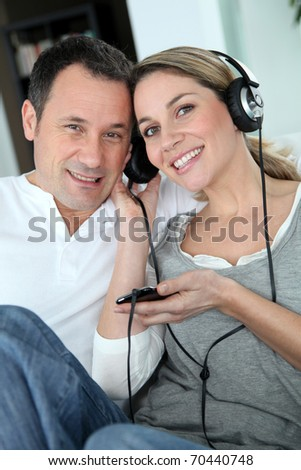 Couple listening to music with headphones