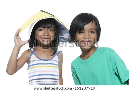 couple little girl with books in the head