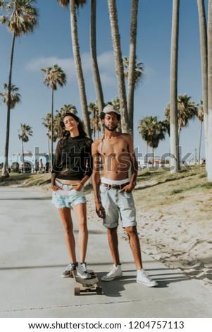 Couple longboarding at Venice Beach