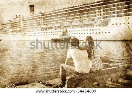 couple looking at cruise liner. ...
