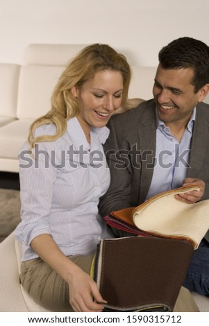 Couple looking at fabric swatches