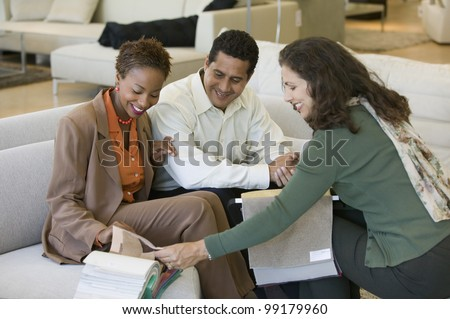 Couple Looking at Swatches With Saleswoman