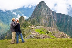 Couple looking at the Lost city of the Incas, Machu Picchu, Peru