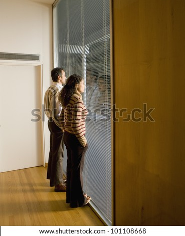 Couple looking out window