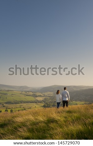 couple looking over a valley to hills beyond