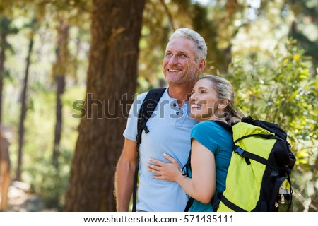 Couple looking something and holding each other