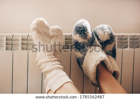 Couple love. Legs with socks on heating radiator. Couple. Romantic lovers.
