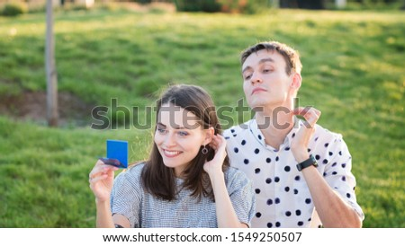 Couple lover enjoy honeymoon and long vacation, together relax and confortable, valentine occasion. Girl and guy spend time together in park. Lovers enjoying to each other and joint pranks. #1549250507