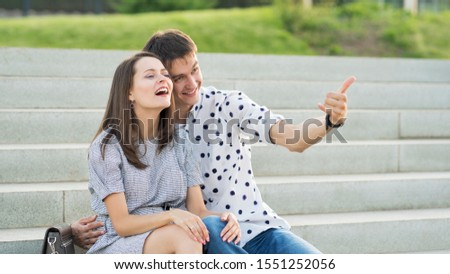 Couple lover enjoy honeymoon and long vacation, together relax and confortable, valentine occasion. Girl and guy spend time together in park. Lovers enjoying to each other and joint pranks. #1551252056
