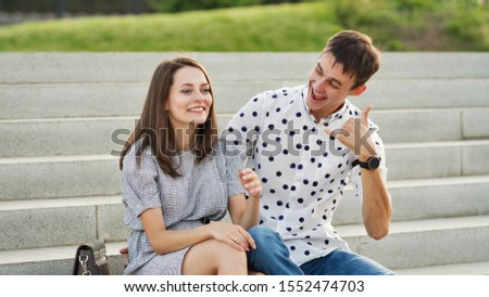 Couple lover enjoy honeymoon and long vacation, together relax and confortable, valentine occasion. Girl and guy spend time together in park. Lovers enjoying to each other and joint pranks. #1552474703