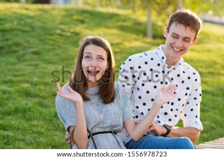 Couple lover enjoy honeymoon and long vacation, together relax and confortable, valentine occasion. Girl and guy spend time together in park. Lovers enjoying to each other and joint pranks. #1556978723
