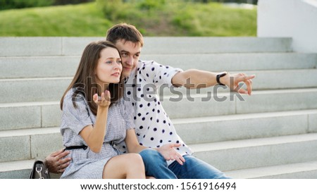 Couple lover enjoy honeymoon and long vacation, together relax and confortable, valentine occasion. Girl and guy spend time together in park. Lovers enjoying to each other and joint pranks. #1561916494
