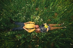couple lying in a field of flowers. Happy couple lie in a flower. Romance, emotional and love scene