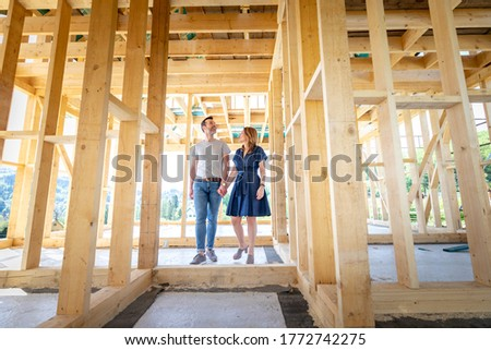 Couple make their dreams of building their own home come true visiting house under construction ストックフォト ©