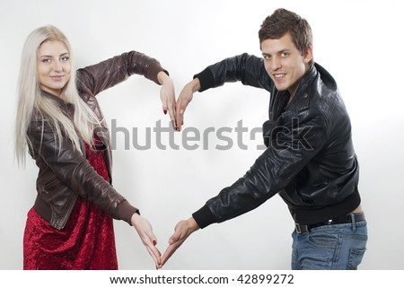 Couple making the shape of a heart
