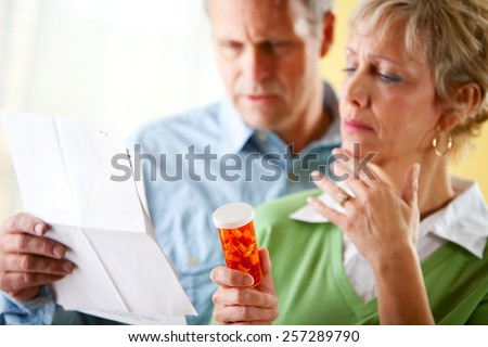 Couple: Man and Woman Concerned About Prescription