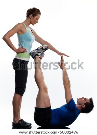couple,man and woman doing abdominals workout posture on isolated white background