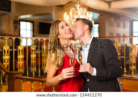 stock-photo-couple-man-and-woman-drinking-champagne-in-a-fine-dining-restaurant-each-with-glass-of-sparkling-124411270 Latino Wife Locater - How to Start Relationships With Latin Females