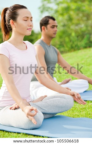 Couple meditating on fresh air