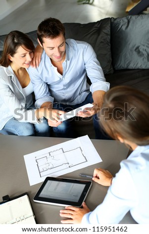 Couple meeting consultant for financial contract - stock photo
