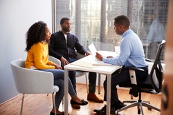 Couple Meeting With Male Financial Advisor Relationship Counsellor In Office