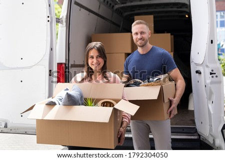 Couple Moving Boxes From Van Or Truck Together Outdoors Photo stock ©