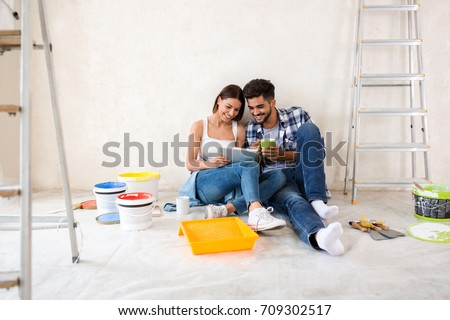 Couple moving in new renovate home, looking new design for home Foto stock ©