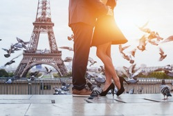couple near Eiffel tower in Paris, romantic kiss