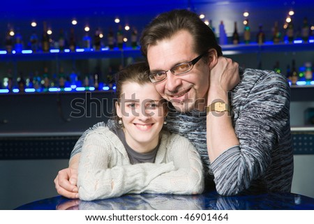 Couple of adults in cafe talking
