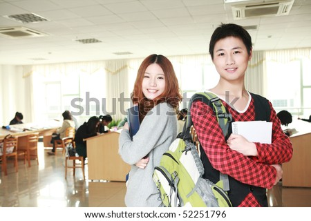 couple of asian student in classroom - stock photo
