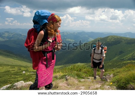 Couple of backpackers hiking in a mountains