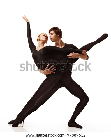 Couple of ballet dancers posing over isolated white background