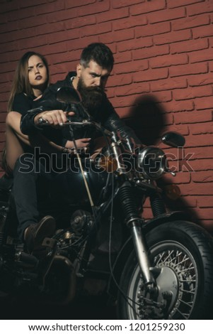 Couple of bikers on motorcycle ready to travel. Hipster and woman sit on retro motorbike, travel concept. Just go. #1201259230